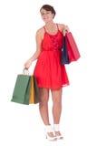 Stående av att bedöva den unga kvinnan med shoppingpåsen Arkivfoto