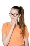 Stående av att charma den eftertänksamma tonårs- flickan på vit bakgrund royaltyfria bilder