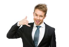 Stående av att göra en gest för affärsmantelefon royaltyfria bilder