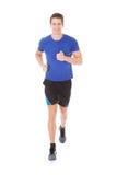 Stående av att jogga för ung man Arkivfoto