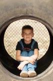 Stående av att le årig pojke sju Årig pojke sju med Fotografering för Bildbyråer