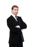 Stående av att le affärsmannen med korsade armar Arkivbild