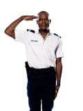 Stående av att salutera för polis Royaltyfria Bilder