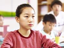 Stående av den asiatiska grundskolastudenten Arkivbilder