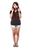Stående av den asiatiska lyckliga unga flickan i handling Royaltyfri Bild