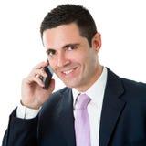 Stående av den attraktiva affärsmannen i dräkt som talar på smart pho Royaltyfri Bild