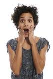 Stående av den chockade latinamerikanska kvinnan med den öppna munnen Fotografering för Bildbyråer