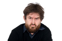 Stående av den emotionella mannen med ett skägg Royaltyfria Bilder