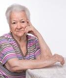 Stående av den gamla kvinnan fotografering för bildbyråer