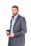 Stående av den gladlynt affärsmannen med glass wine Royaltyfri Bild
