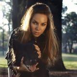 Stående av den härliga flickan med en hund royaltyfria foton