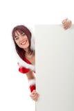 Stående av den härliga flickan som bär Santa Claus kläder royaltyfria foton