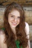 Stående av den härliga röda haired flickan Arkivfoton