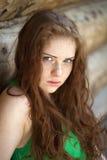 Stående av den härliga röda haired flickan Arkivfoto