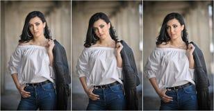Stående av den härliga sexiga unga kvinnan med den moderna dräkten, läderomslaget, jeans, den vita blusen och svartkängor Arkivbild