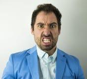 Stående av den ilskna sinnessjuka affärsmannen arkivfoto