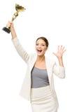 Stående av den lyckliga affärskvinnan med den guld- koppen royaltyfri fotografi