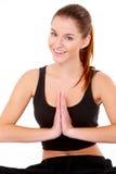 Stående av den nätt unga kvinnan som gör yoga Fotografering för Bildbyråer