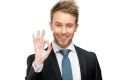 Stående av den ok göra en gest affärsmannen arkivbild