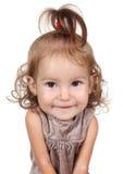 Stående av den roliga stora head barnflickan på vit Arkivbild
