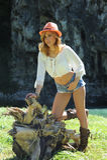 Stående av den stilfulla cowgirlen utomhus Royaltyfria Bilder