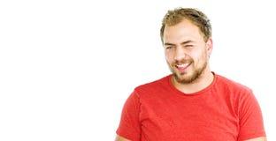 Stående av den stiliga skäggiga unga mannen med att stråla leende fotografering för bildbyråer