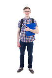 Stående av den stiliga tonårs- pojken med den isolerade ryggsäcken och boken Fotografering för Bildbyråer
