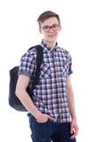 Stående av den stiliga tonårs- pojken med ryggsäcken som isoleras på vit Arkivbild