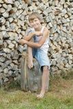 Stående av den tonårs- timberjackskördearbetaren Arkivfoto