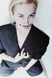 Stående av den unga kvinnan med den målade mustaschen royaltyfria bilder