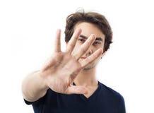 Stående av den unga mannen som gör en gest stoppet Royaltyfria Bilder