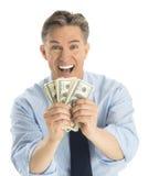 Stående av den upphetsade affärsmannen Showing Dollar Bills Royaltyfri Foto