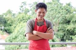 Stående av det asiatiska röda förklädet för mankläder Royaltyfria Foton
