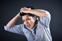 Stående av en affärsman med en huvudvärk Arkivfoto