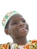 Stående av en afro- pojke som ler, tio gamla år, isolerat royaltyfria foton