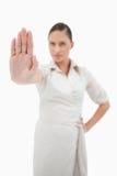 Stående av en fitaffärskvinna som gör ett stopptecken Royaltyfria Foton