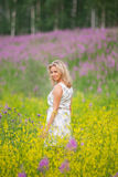 Stående av en flicka med blommor Royaltyfria Foton