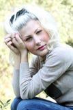 Stående av en flicka med blont hår Royaltyfri Bild