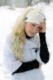 Stående av en flicka med blont hår i vinter Fotografering för Bildbyråer