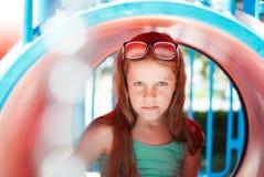 Stående av en flicka på lekplatsen Arkivbild