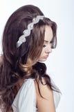 Stående av en flicka på vit bakgrund Fotografering för Bildbyråer