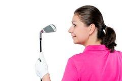 Stående av en golfare med klubban och utrymmet till det vänstert Royaltyfria Foton