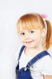 Stående av en gullig liten flicka fotografering för bildbyråer