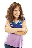 Stående av en gullig ung flicka som ser upp royaltyfria foton