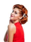 Stående av en härlig flicka i en röd klänning Arkivfoton