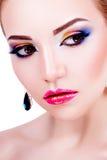 Stående av en härlig ung flicka med yrkesmässig makeup Arkivbilder