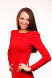 Härlig ung kvinna i röd klänning Royaltyfria Foton