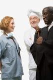 Stående av en kirurg en domare och en kock Arkivfoto