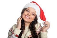 Stående av en kvinna i den santa hatten arkivfoton