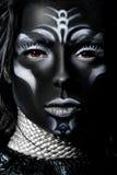 Stående av en kvinna med idérikt smink Arkivfoton
